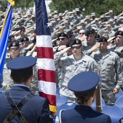Tactical Air Control Party members and students enrolled in technical training at the 353rd Battlefield Airmen Training Squadron salute the flag during the national anthem at the TAC-P Memorial Rededication ceremony outside the 353rd BATS at the Joint Base San Antonio-Lackland Medina Annex June 23, 2017. The 353rd BATS held a memorial ceremony and rededicated the memorial that stands outside of the squadron to fallen TAC-P members and those who provided support to them. The TAC-P mission is to defeat the enemy through the use of airpower while protecting ground forces and non-combatants from the effects of friendly air to ground attacks. (U.S. Air force photo by Airman Dillon Parker)