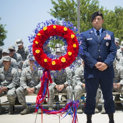 Master Sgt. Jeffery Mader stands next to the wreath during the Tactical Air Control Party Memorial Rededication Ceremony outside the 353rd Battlefield Airmen Training Squadron at the Joint Base San Antonio-Lackland Medina Annex June 23, 2017. Each of the gold roses placed on the wreath represent one of the fallen on the memorial. (U.S. Air force photo by Airman Dillon Parker)